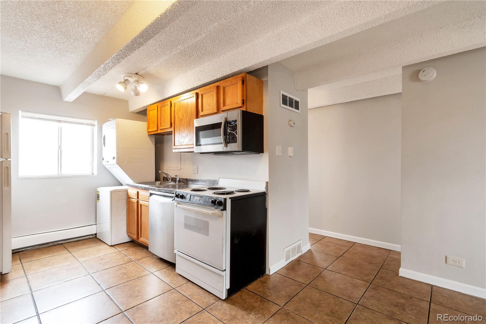 MLS# 5561561 - 2 - 1180 Yosemite Street #202, Denver, CO 80220