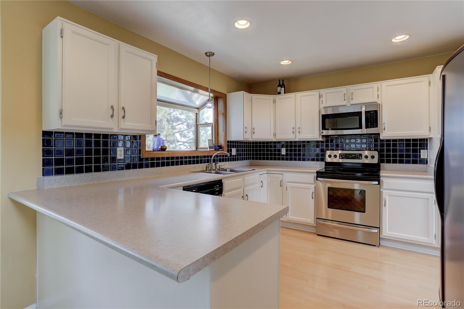 MLS# 9389187 - 3 - 1245 Goldsmith Drive, Highlands Ranch, CO 80126