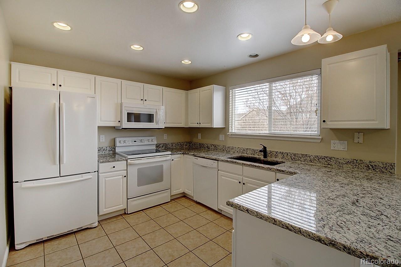 MLS# 9395452 - 12 - 1001 Riddlewood Lane, Highlands Ranch, CO 80129