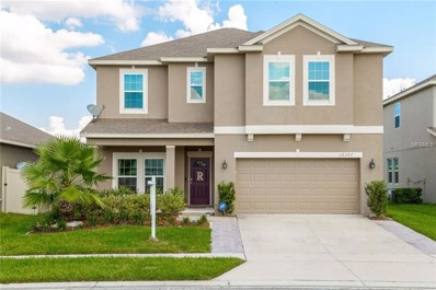 12357 Sawgrass Prairie Loop, Orlando, FL 32824 - #: O5735529