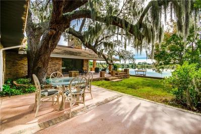 1910 College Park Drive, Tavares, FL 32778 - MLS#: O5744291