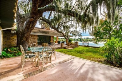 1910 College Park Drive, Tavares, FL 32778 - #: O5744291