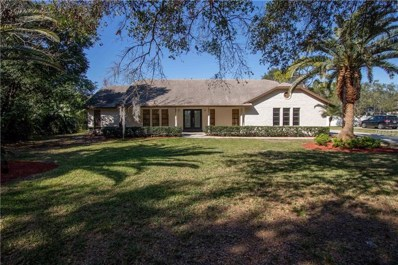 4606 Woodlands Village Drive, Orlando, FL 32835 - #: O5764153