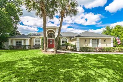 4520 Woodlands Village Drive, Orlando, FL 32835 - #: O5778221