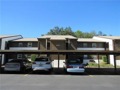 4041 Passport Lane UNIT 104, New Port Richey, FL 34653 - MLS#: U8023097