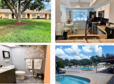 8121 Braddock Circle UNIT 5, Port Richey, FL 34668 - MLS#: W7813303