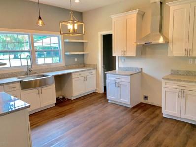 Interlachen, FL home for sale located at 141 E Strickland Rd, Interlachen, FL 32148