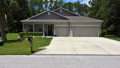 Palm Coast, FL home for sale located at 61 Woodlawn Dr, Palm Coast, FL 32164
