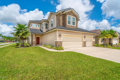 St Augustine, FL home for sale located at 27 Harris Hawk Ct, St Augustine, FL 32092