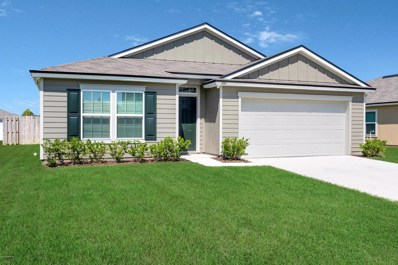 Green Cove Springs, FL home for sale located at 3352 Canyon Falls Dr, Green Cove Springs, FL 32043