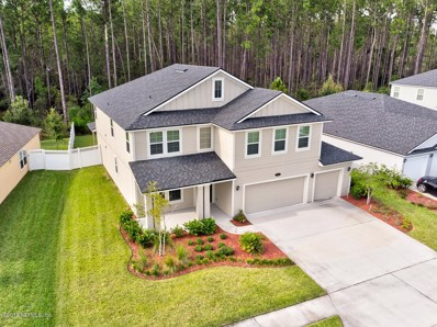 St Johns, FL home for sale located at 390 Grampian Highlands Dr, St Johns, FL 32259