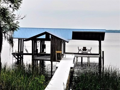 Crescent City, FL home for sale located at 104 Hummingbird Trl, Crescent City, FL 32112
