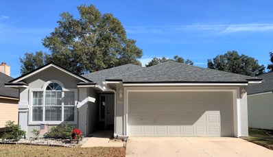 St Johns, FL home for sale located at 725 Tee Time Ln, St Johns, FL 32259
