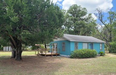 Hollister, FL home for sale located at 719 State Road 20, Hollister, FL 32147
