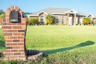 Callahan, FL home for sale located at 44195 Hunters Green Dr, Callahan, FL 32011