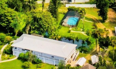 12 St Johns Ave, Palm Coast, FL 32137 - #: 1085974