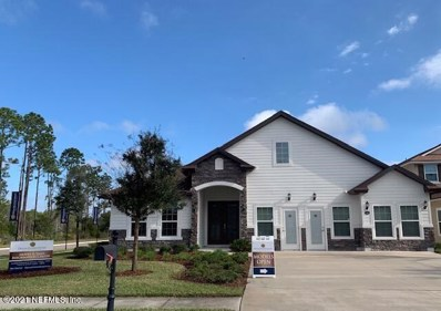 Palm Coast, FL home for sale located at 100 Vireo Dr, Palm Coast, FL 32164