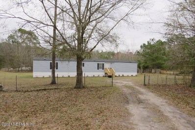 Green Cove Springs, FL home for sale located at 5051 Ravenwood Dr, Green Cove Springs, FL 32043