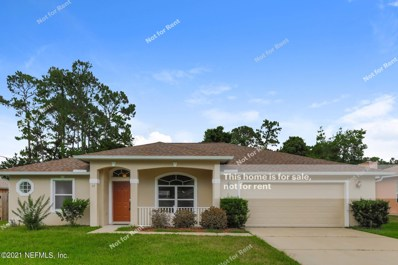 Palm Coast, FL home for sale located at 12 Woodward Ln, Palm Coast, FL 32164