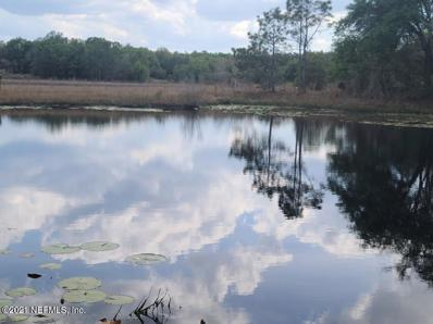 Interlachen, FL home for sale located at 220 Duval Ave, Interlachen, FL 32148