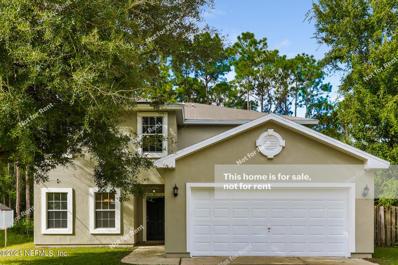 Palm Coast, FL home for sale located at 54 Llama Trl, Palm Coast, FL 32164
