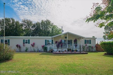 Crescent City, FL home for sale located at 127 Carolina St, Crescent City, FL 32112