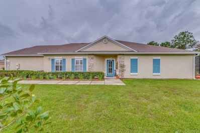 Fleming Island, FL home for sale located at 1646 Calming Water Dr, Fleming Island, FL 32003