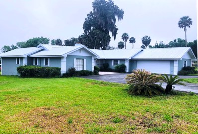 Crescent City, FL home for sale located at 730 N Park St, Crescent City, FL 32112