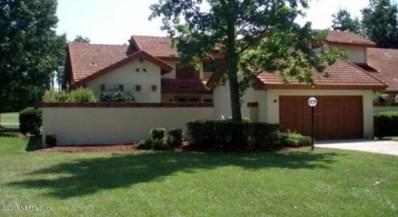 Palm Coast, FL home for sale located at 33 Village Cir, Palm Coast, FL 32164
