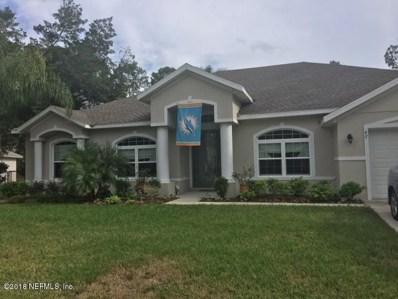 Palm Coast, FL home for sale located at 62 Burning Bush Dr, Palm Coast, FL 32137