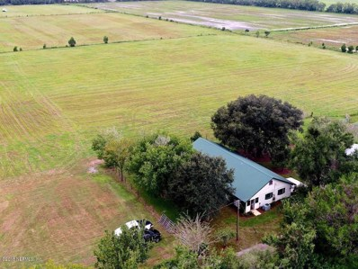 Bunnell, FL home for sale located at 614 County Road 95, Bunnell, FL 32110