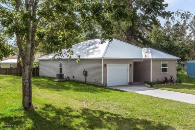 St Augustine, FL home for sale located at 319 Ravenswood Dr, St Augustine, FL 32084