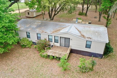 Interlachen, FL home for sale located at 132 Walker Dr UNIT 17, Interlachen, FL 32148