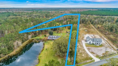 Callahan, FL home for sale located at 43236 Ratliff Rd, Callahan, FL 32011