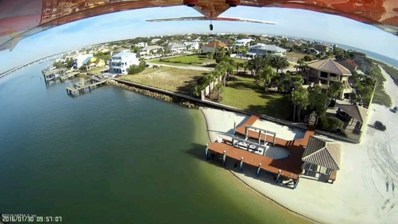 St Augustine, FL home for sale located at 405 Porpoise Point Dr, St Augustine, FL 32084