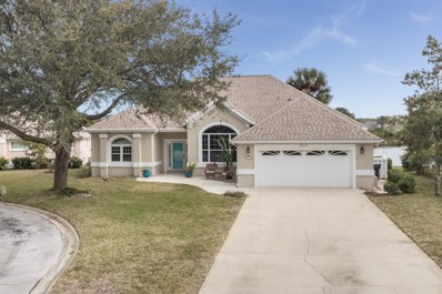 St Augustine, FL home for sale located at 11 Anastasia Lakes Dr, St Augustine, FL 32080