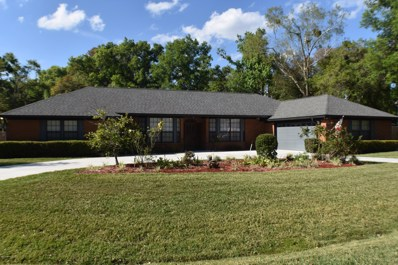 St Johns, FL home for sale located at 681 Remington Forest Dr, St Johns, FL 32259