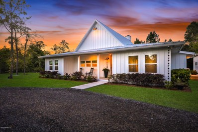 St Augustine, FL home for sale located at 7718 Colee Cove Rd, St Augustine, FL 32092