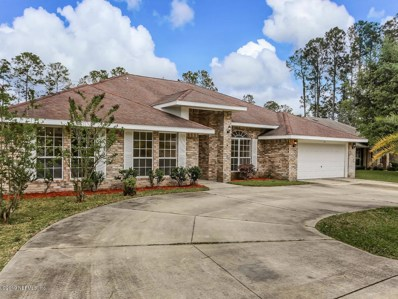 Palm Coast, FL home for sale located at 24 Reybury Ln, Palm Coast, FL 32164