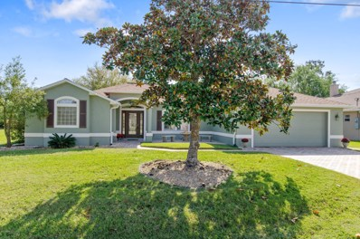Palm Coast, FL home for sale located at 72 Lynbrook Dr, Palm Coast, FL 32137