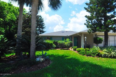 Palm Coast, FL home for sale located at 21 Cherrytree Ct, Palm Coast, FL 32137