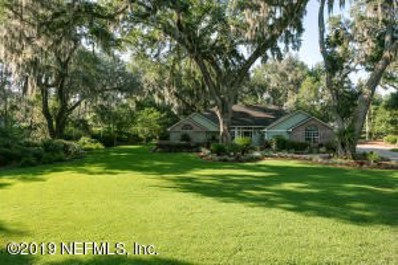 St Johns, FL home for sale located at 1076 Holly Oaks Ct, St Johns, FL 32259